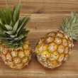 Stock Photo: Pineapple on table of acaciwood