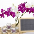 Stock Photo: Bouquet of orchids with slate