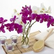 Stock Photo: Wellness - Bath brush, towel, orchids and tealights