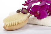 Wellness - Bathbrush, towel and purple orchid — Stock Photo