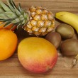 Stock Photo: Multivitamin - Pineapple, oranges, banana, kiwi and mango