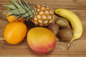Multivitamin - Pineapple, oranges, banana, kiwi and mango — Stock Photo