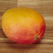 Stock Photo: Mango on tabletop of acaciwood