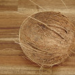 Stock Photo: Coconut on tabletop of acaciwood