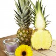 Stock Photo: Pineapple and half on tabletop of acaciwood