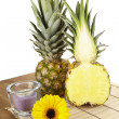 Pineapple and half on tabletop of acaciwood — Stock Photo #40458773