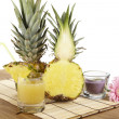 Glass of pineapple juice and pineapple — Stock Photo #40459125