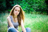 Young woman sits — Stock Photo