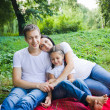 Family hugs in park — Stock Photo #30635973