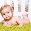 Pretty baby with big blue eyes — Stock Photo