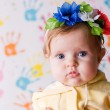 Stock Photo: Cute little baby with flowers