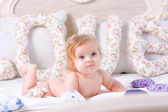 Cute little baby lies down on the bed — Stock Photo