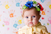 Cute little baby with flowers — Stock Photo