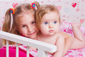 Two happy sisters hug — Stock Photo