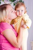 Mother kisses child — Stock Photo