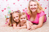 Happy family lies on the bed — Stock Photo