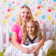 Happy mother and daughter sit — Stock Photo