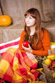 Young pretty woman holds an apple — Stock Photo