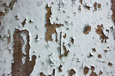 Textrure of peeling painted rusted wall — Stock Photo