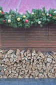Christmas Garland and Woodpile — Stock Photo