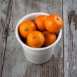 Mandarins in white metal bucket top view — Stock Photo #35148219