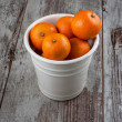 Mandarins in metal bucket — Stock Photo #35148221