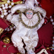 Doll toy on a celebratory tinsel — Stock Photo