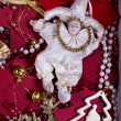 Doll toy in a tinsel festive ambience — Stock Photo
