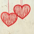 Two red paper hearts on a old white wood — Stock Photo