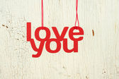 Words love you on a old white wood background — Stock Photo