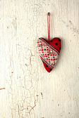 Heart symbol hand made on a old wooden door — Stock Photo