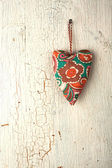 Heart hand made on a old wooden door — Stock Photo