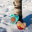 Stock Photo: Two handmade hearts on a snow background