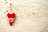 Heart hand made on a white wooden door — Stock Photo