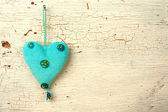 Blue heart hand made on a white old wooden door — Stock Photo