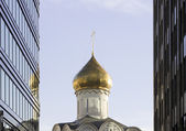 Orthodoxy church between skyscrapers — Stock Photo