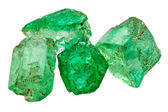 Four emerald crystals — Stock Photo