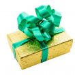 Golden gift box with green bow — Stock Photo