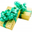 Golden gift box with green bow — Stock Photo #36966401