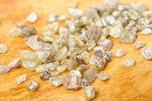 Uncut diamonds on birch — Stock Photo