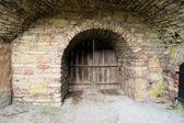 Wooden door in stone valv — Stock Photo