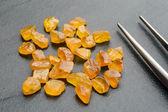 Uncut sapphires with tweezers — Stock Photo