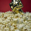 Stock Photo: Oscar and popcorn