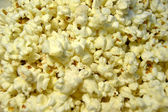 Popcorn with red background — Stock Photo