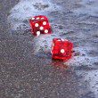Dices on the beach — Stock Photo