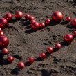Heart on the beach — Stock Photo
