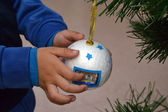 Kid with christmas ball — Stock Photo
