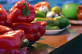 Green and red peppers — Stock Photo