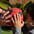 Mother and son playing with red ball — Stock Photo