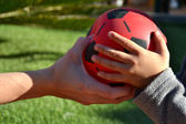 Mother and son playing ball — Stock Photo